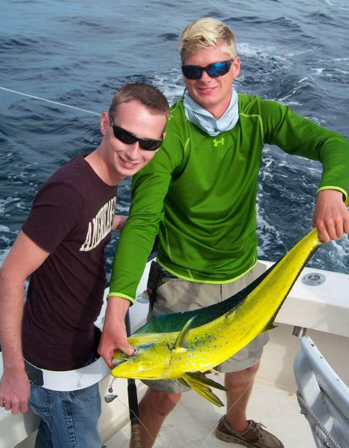 Two young Ocean City anglers holding a beautifully colored mahi.